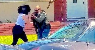 Illustration for article titled Video: US Marshal Rushes Woman Filming Him, Breaks, Kicks Camera
