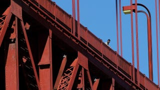 A visitor looks over the railing on the Golden Gate Bridge in San Francisco on March 12, 2014. A reported 46 people jumped to their deaths from the bridge in 2013.Justin Sullivan/Getty Images