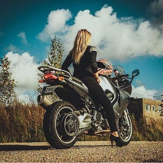 have this girl with poor choices in riding footwear on an F800ST for your time.