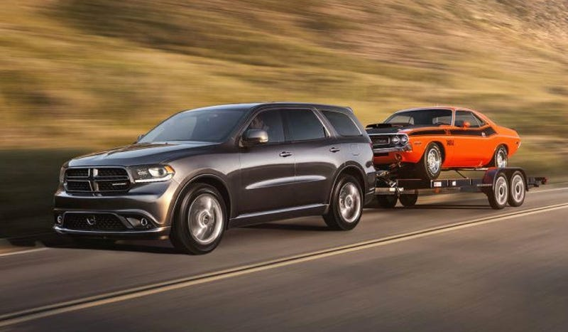 Illustration for article titled Hey Look It's The 2014 Dodge Durango And It Can Tow Cars And Has LEDs