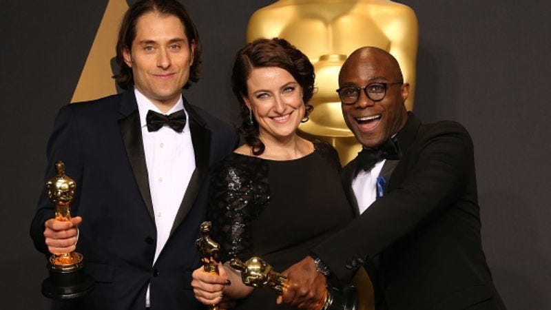 It took a while, but Jeremy Kleiner, Adele Romanski and Barry Jenkins eventually accepted their Oscars (Photo: Dan MacMedan/Getty Images)