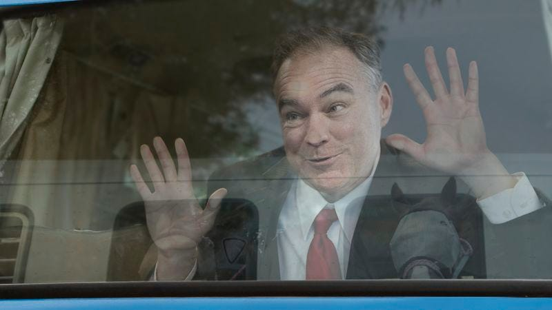 Illustration for article titled Giddy Tim Kaine Presses Face Against Campaign Bus Window As Horse Trailer Drives By