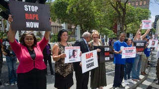 A protest against rape is held Feb. 11, 2013, outside the parliament in the center of Cape Town. The protest was called for after the gang-rape and mutilation of 17 year-old Anene Booysen, who eventually died of her injuries, on Feb. 2, 2013.RODGER BOSCH/AFP/Getty Images