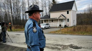 A Maine State Police officer walks in front of the home where nurse Kaci Hickox is staying with her boyfriend, Theodore Michael Wilbur, Oct. 30, 2014, in Fort Kent, Maine. Spencer Platt/Getty Images
