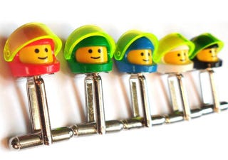 Illustration for article titled I Must Get These Lego Classic Space Minifig Cufflinks
