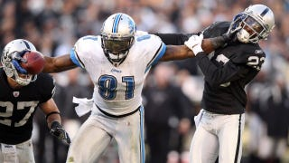 Illustration for article titled Calvin Johnson Meets Randy Moss: Two Wide Receivers Bigger Than The Game
