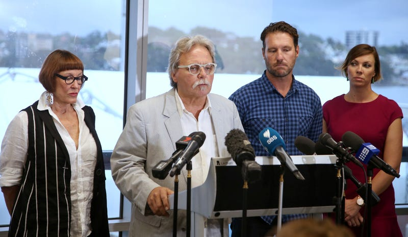 "John Ruszczyk, second left, is supported by his wife Maryan Heffernan, left, his son Jason Ruszczyk and his wife Katarina, right, as he makes a statement in Sydney, Thursday, Dec. 21, 2017, demanded a more rigorous probe into the fatal shooting of his daughter, Justine Ruszczyk Damond, by Minneapolis police. John Ruszczyk said his family was deeply concerned about the possibility ""the initial investigation was not done properly, and with the greatest integrity or sense of completeness."""