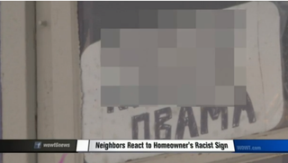 An offensive sign sits in the window of Steve Bowman's residence.WOWT Screenshot