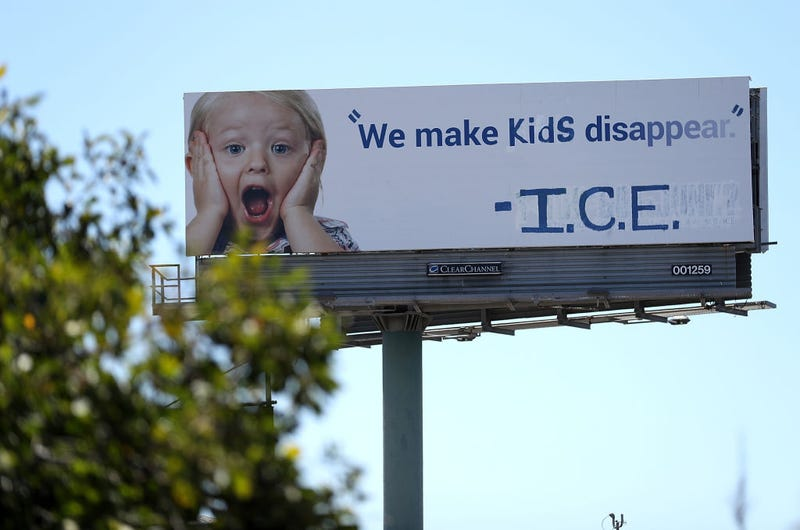 A vandalized 1-800-GOT-JUNK billboard shows a message in in protest with the Immigration and Customs Enforcement (ICE) and their participation in separating children from their parents trying to enter the U.S. from Mexico on June 21, 2018 in Emeryville, California.