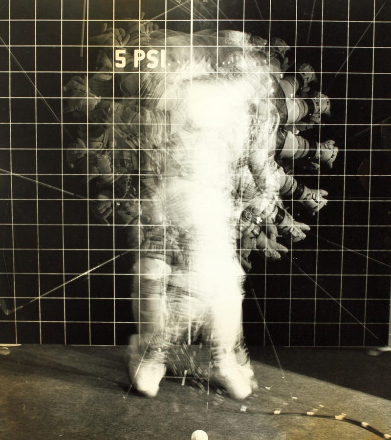 Illustration for article titled Vintage NASA spacesuit photos are delightfully trippy