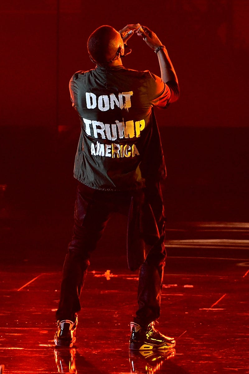 """Usher performs onstage wearing his """"Don't Trump America"""" jacket during the 2016 BET Awards in Los Angeles on June 26, 2016.  Kevin Winter/BET/Getty Images for BET"""