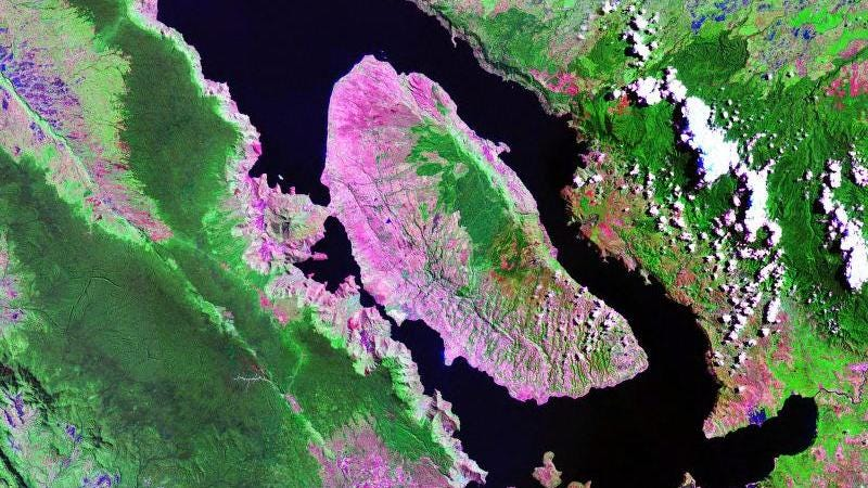 A satellite image of Lake Toba, Indonesia. Some 74,000 years ago, this caldera exploded, hurtling thousands of tons of ash into the atmosphere.