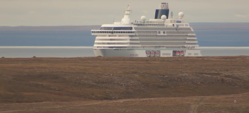 """""""Its thirteen decks of luxury towered over the bleak, flat Arctic landscape,"""" reports The National, from which this screencap is pulled."""