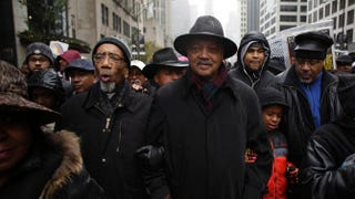 Rep. Bobby Rush (D-Ill.) and the Rev. Jesse Jackson link arms as they march with demonstrators protesting the shooting of Laquan McDonald along the Magnificent Mile Nov. 27, 2015, in Chicago.Joshua Lott/Getty Images