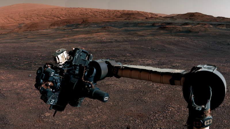 Curiosity's robotic arm and Mount Sharp are visible in this cropped image from the new panorama.