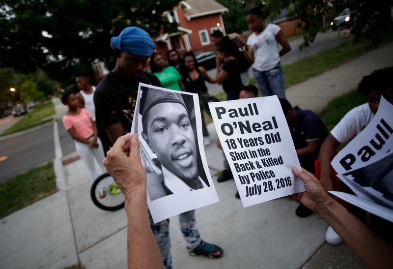 Demonstrators in Chicago on Aug. 5, 2016, distribute photos of Paul O'Neal before protesting his fatal shooting by a Chicago police officer.Joshua Lott/Getty Images
