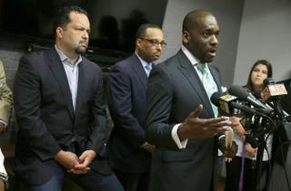 The Rev. Jamal Bryant of Empowerment Temple speaks as Ben Jealous (left) of Southern Elections Fund and Todd Yeary of the Maryland NAACP listen during a news conference June 8, 2015, in Baltimore.Alex Wong/Getty Images
