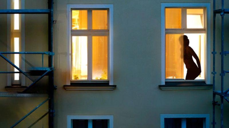 Hero Woman Changes In Front Of Open Window