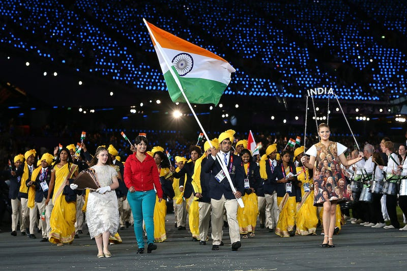 Illustration for article titled Mystery Woman Horning In On Opening Ceremony March Pisses Off Most Of India