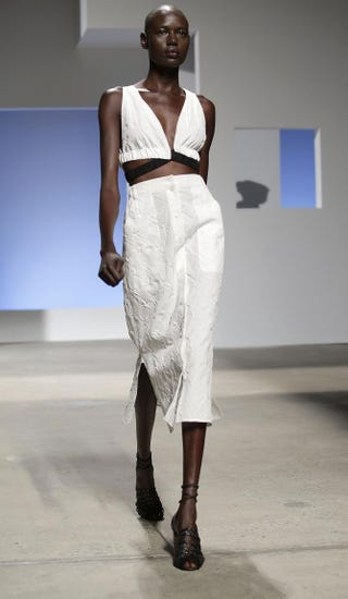 Sudanese model Ajak Deng presents a creation by Thakoon during his Spring/Summer 2016 collection at New York Fashion Week in New York City on Sept. 13, 2015.JOSHUA LOTT/Getty Images