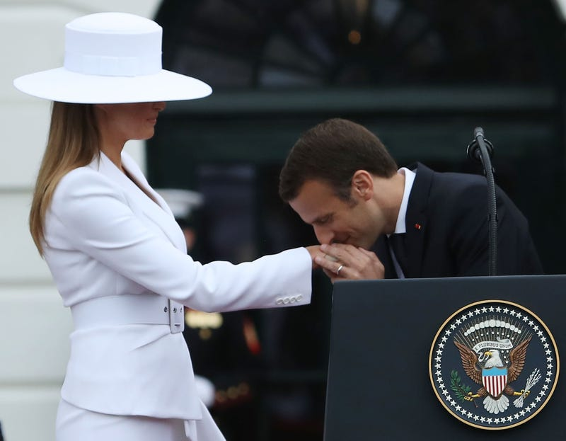 French President Emmanuel Macron kisses the hand of U.S. first lady Melania Trump during an arrival ceremony at the White House for Macron on April 24, 2018, in Washington, D.C.