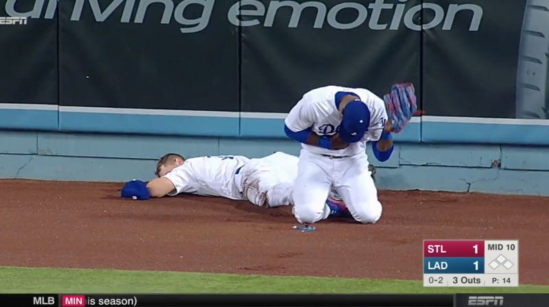 Pederson out after outfield collision with Puig