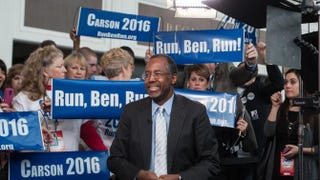 Ben Carson is surrounded by supporters Feb. 26, 2015, as he waits to be interviewed at the annual Conservative Political Action Conference at National Harbor, Md.Nicholas Kamm/AFP/Getty Images
