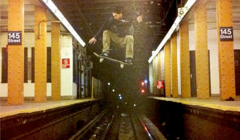 Illustration for article titled Yes, This Shot Of A Skateboarder Jumping Over A New York City Subway Track Is Real