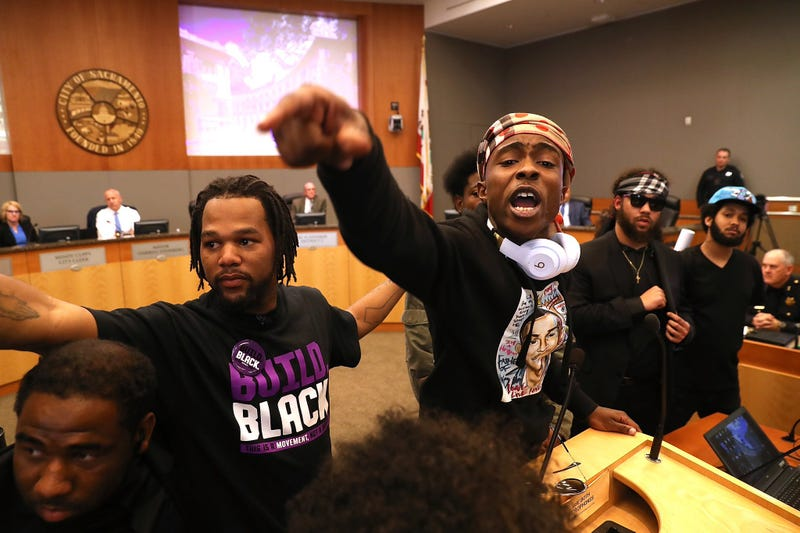 Stevante Clark (center, right), brother of Stephon Clark, interrupts a Sacramento, Calif., City Council meeting on March 27, 2018.