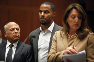Former pro football player Darren Sharper appears in Los Angeles court, along with his attorneys Leonard Levine and Blair Berk, Feb. 14, 2014.Liz O. Baylen-Pool/Getty Images