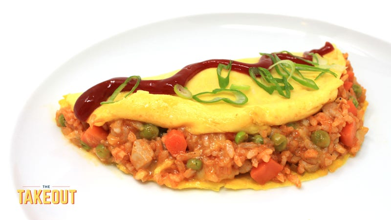 Illustration for article titled Make omurice, the irresistible Japanese ketchup fried rice omelet—wait, come back