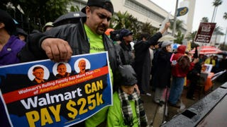 Protesters outside a Wal-Mart in the Crenshaw district of Los Angeles on Black Friday, Nov. 29, 2013ROBYN BECK/AFP/Getty Images