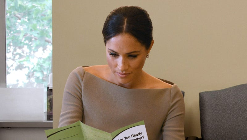 Illustration for article titled Meghan Markle Nervously Looking Over Clinic Pamphlets Weighing Her Options