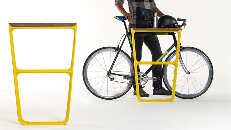 Illustration for article titled All Bike Racks Should Have a Neat Storage Shelf Like This