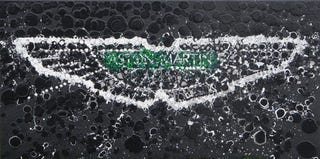 Illustration for article titled The Art Of The Aston Martin Logo