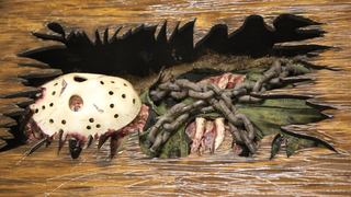 Illustration for article titled The Decaying Body Of Friday The 13th's Jason Lies Inside This Table