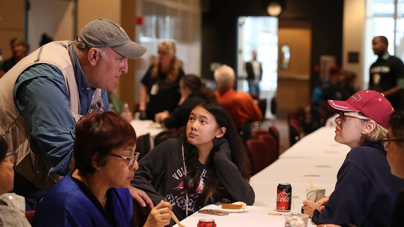Jose Andres talks with wildfire evacuees during a community Thanksgiving dinner at California State University Chico on November 22 in Chico, California.