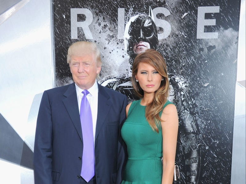 "Donald and Melania Trump, with Batman looming in the background, at the July 16, 2012, New York premiere of ""The Dark Knight Rises"""