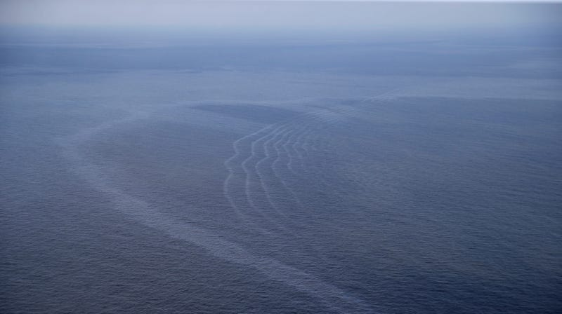 This March 31, 2015, aerial file photo shows an oil sheen from the former Taylor Energy oil rig in the Gulf of Mexico, off the coast of Louisiana.