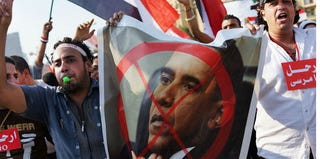 Egyptian protesters carry anti-Obama posters in Tahrir Square in Cairo. (Spencer Platt/Getty Images)
