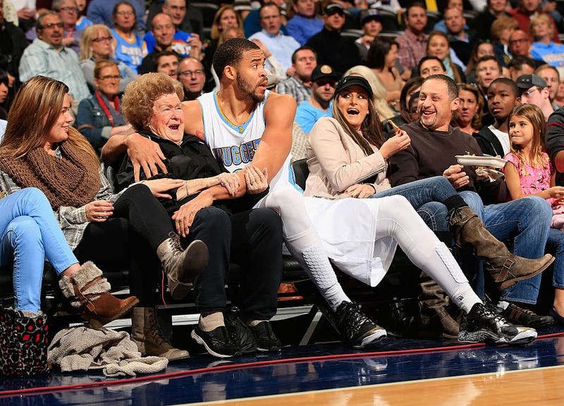 JaVale McGee, No. 34, then playing with the Denver Nuggets, ends up in the front row after saving the ball against the New Orleans Pelicans at Pepsi Center in Denver on Nov. 21, 2014. (Doug Pensinger/Getty Images)