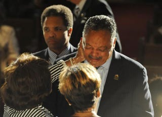 The Rev. Jesse Jackson (center), flanked by his oldest son, Jesse Jackson Jr., mourns his mother, Helen Burns Jackson, who died Sept. 7, 2015, at age 91.John H. White
