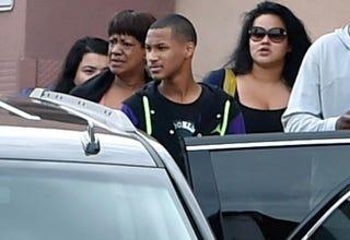 Former NBA player Lamar Odom's aunt JaNean Mercer, son Lamar Odom Jr. and Liza Morales exit through a back door after visiting Lamar Odom at Sunrise Hospital & Medical Center on Oct. 15, 2015, in Las Vegas.David Becker/Getty Images