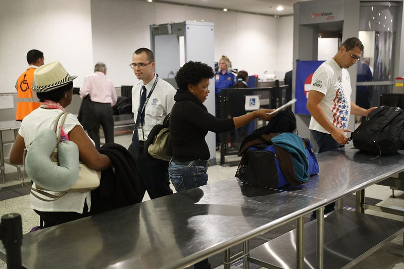 Travelers go through a security point at Miami International Airport on June 2, 2016. (Joe Raedle/Getty Images)