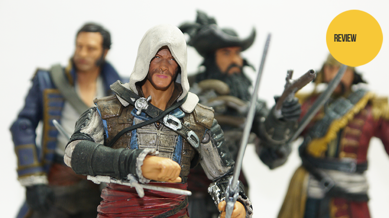 Illustration for article titled I'm Playing Assassin's Creed IV Right Now. On My Desk. With Toys.