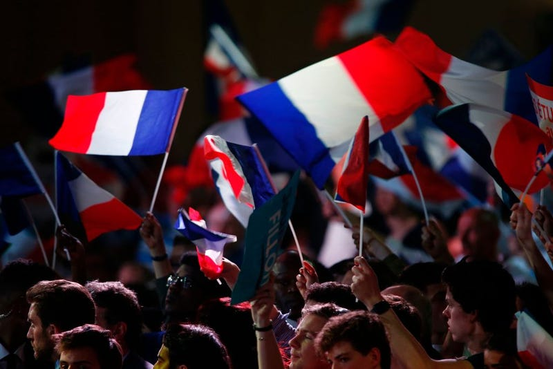 Supporters wave French national flags during a campaign rally at the Porte de Versailles in Paris on April 9, 2017. (Geoffroy Van der Hasselt/AFP/Getty Images)