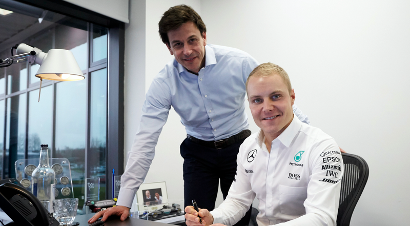 Valtteri Bottas and Mercedes-Benz Motorsport boss Toto Wolff in Brackley, England, announcing Bottas' joining of the Mercedes AMG F1 team. Photo credit: Steve Etherington/Getty Images