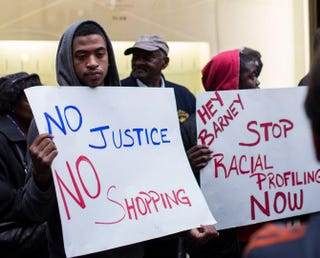 Protesters stand outside the Barneys New York flagship store in New York City.Andrew Burton/Getty Images