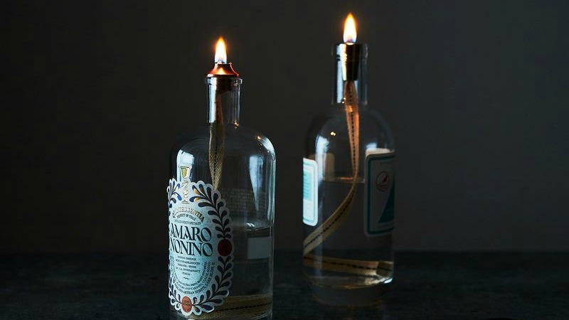 Illustration for article titled Turn Empty Liquor Bottles Into Beautiful Oil Lamps
