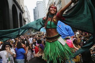 A reveler dressed in indigenous garb dances during the unofficial opening of Rio de Janeiro's 2016 Carnival, which officially begins Feb. 5.Mario Tama/Getty Images